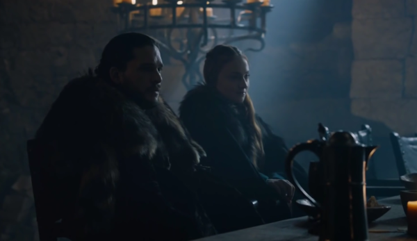 rob_and_sansa_seated_at_the_main_table_inside_the_hall_of_winterfell_listens_in_astonishment_to_lady_lyanna_mormont