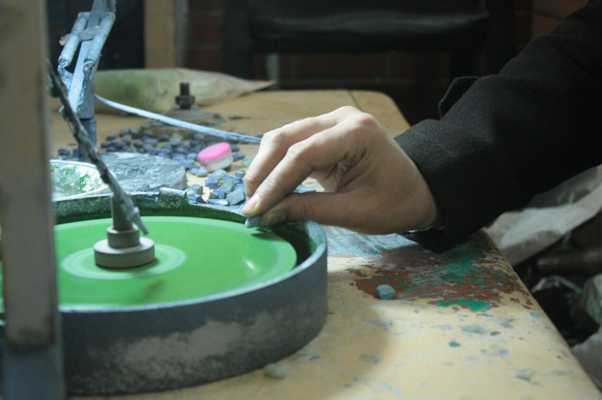Artisans in Kabul, Afghanistan hand polishing stones for Katherine Parr designs